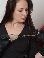 Preview Ladies in leather gloves - Sexy Sammy has her paddle out with her handcuffs ready for some naughty leather fun with her gloves on