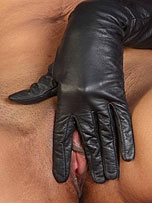 Preview Ladies in leather gloves - Dark skinned beauty wearing some sexy leather gloves with only a pair of stiletto heels on